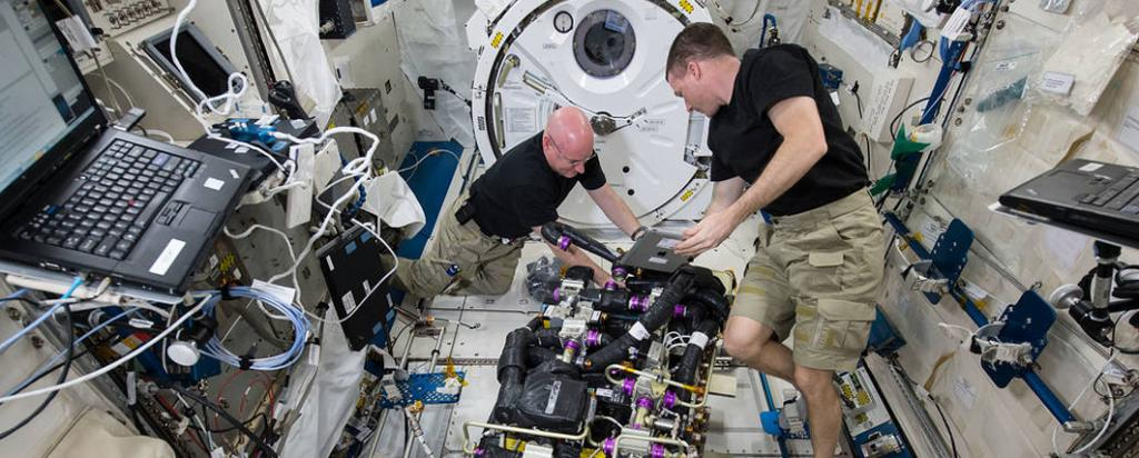 Astronauts carrying out experiments on the ISS